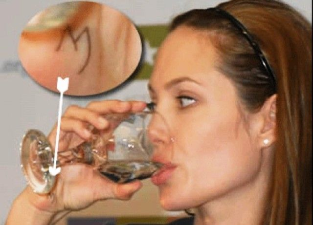 Angelina Jolie tattoo letter M