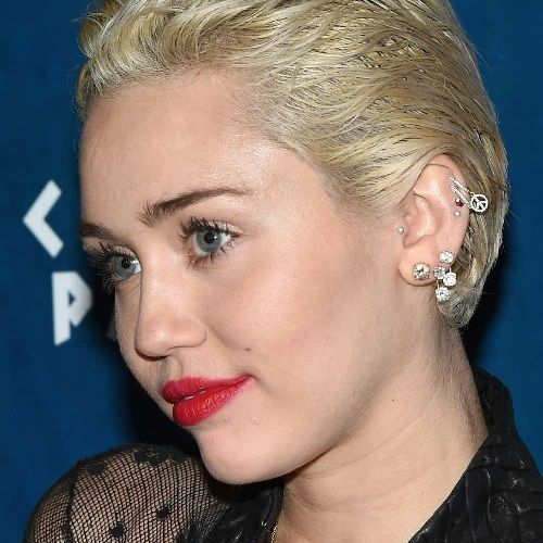 Miley Cyrus Tragus piercings