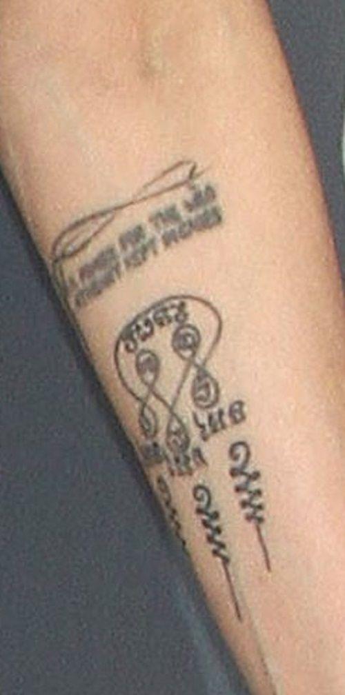 angelina jolie-buddhist swirl tattoo