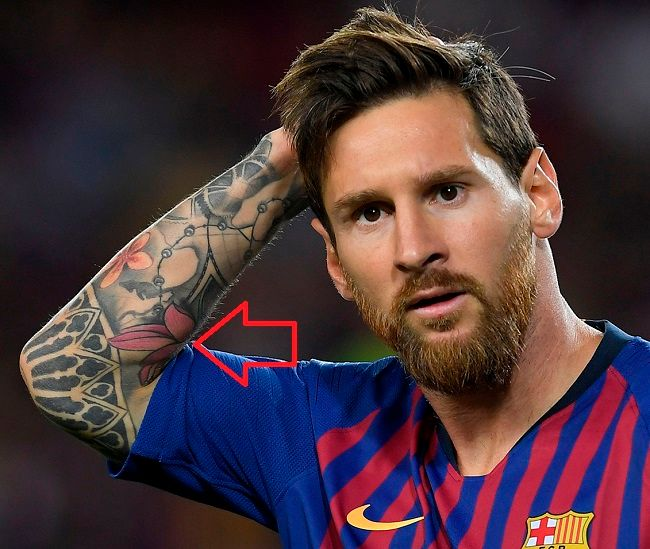 lionel messi-lotus tattoo