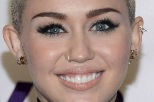 10 Best Known Miley Cyrus Piercings Body Art Guru