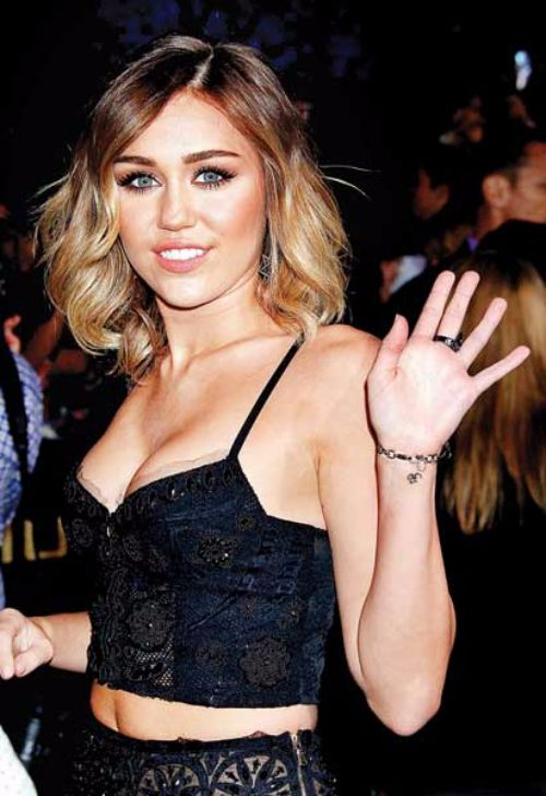 Miley cyrus wrist tattoo