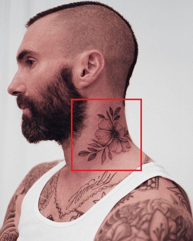 flower tattoo of adam levine