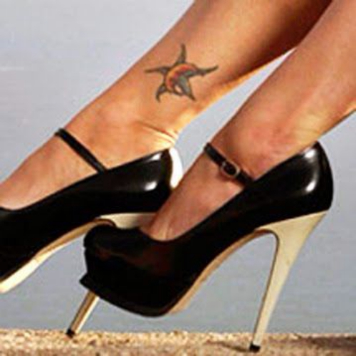 megan fox-crescent moon and star tattoo