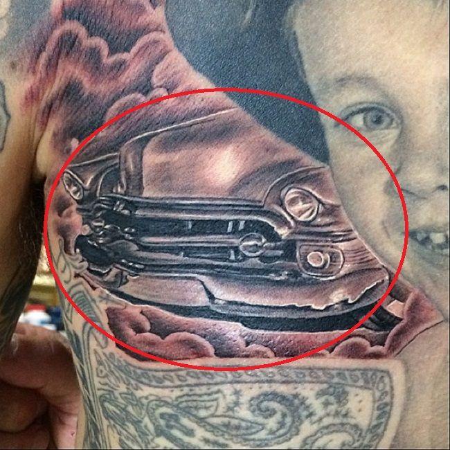 travis barker-cadillac car tattoo