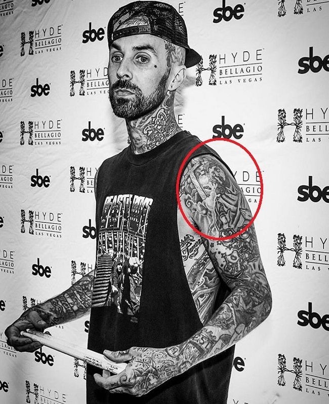 travis barker-jesus with thorny crown and cross tattoo