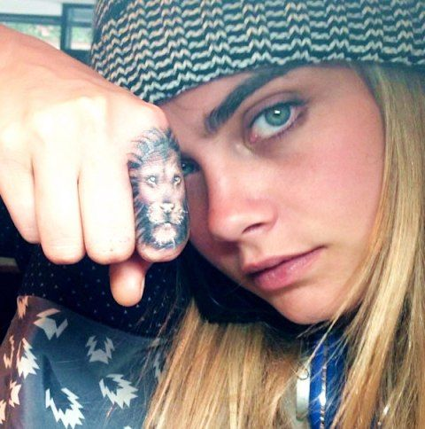 Cara Delevingne tattoo Lion Face