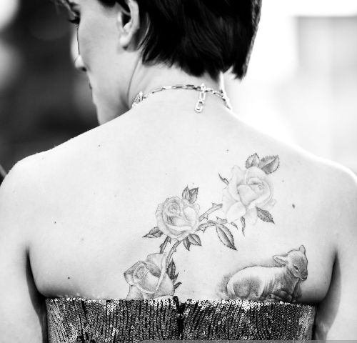 Lamb with floral design tattoo- Johanson