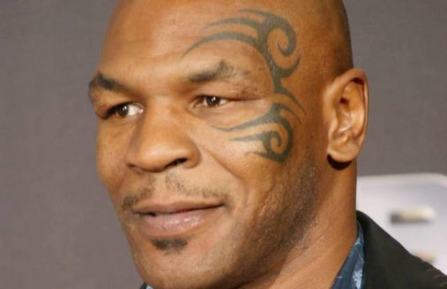 mike tyson s 5 tattoos their meanings body art guru