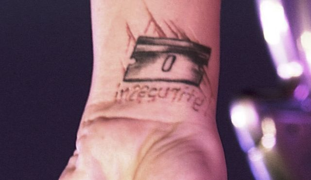 Pink Singer Insecurity Tattoo
