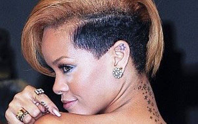 Rihanna tattoos Stars on Her ear