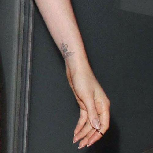 Lily Collins - bristish crown wrist tattoo
