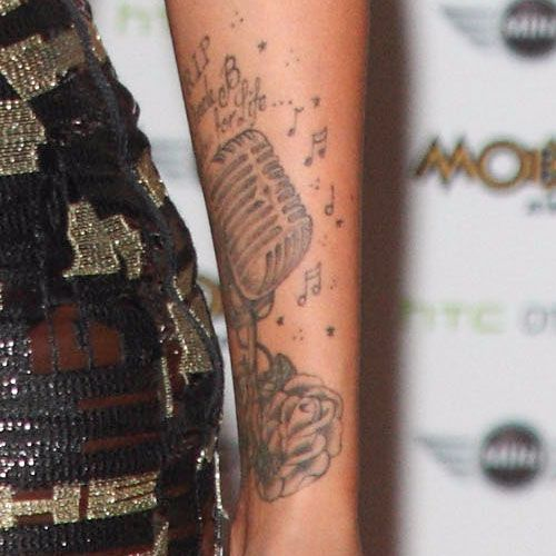 Tulisa Contostavlos - Microphone arm tattoo