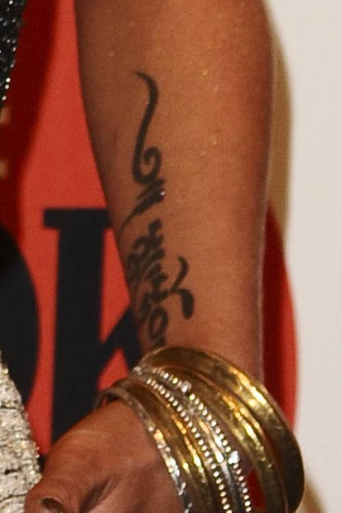 Sarah Harding - Tibetan arm tattoo