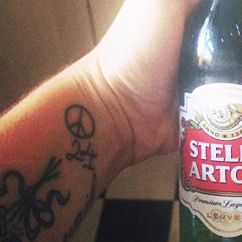 Katie Waissel - wrist peace tattoo