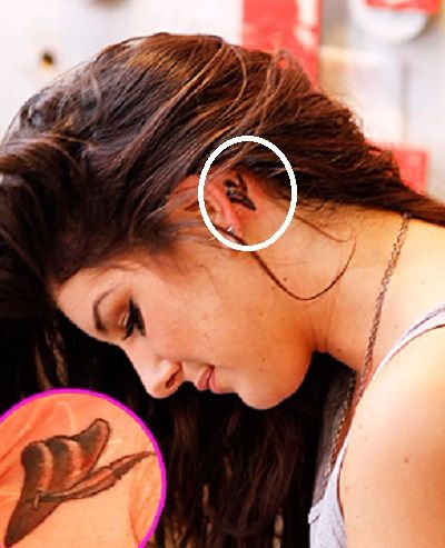 Grimes-ear-tattoo