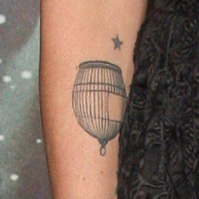 Lena Heady-birdcage-arm-tattoo