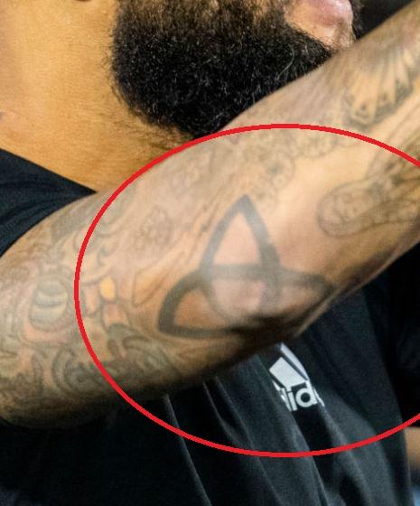 Tim elbow tattoo