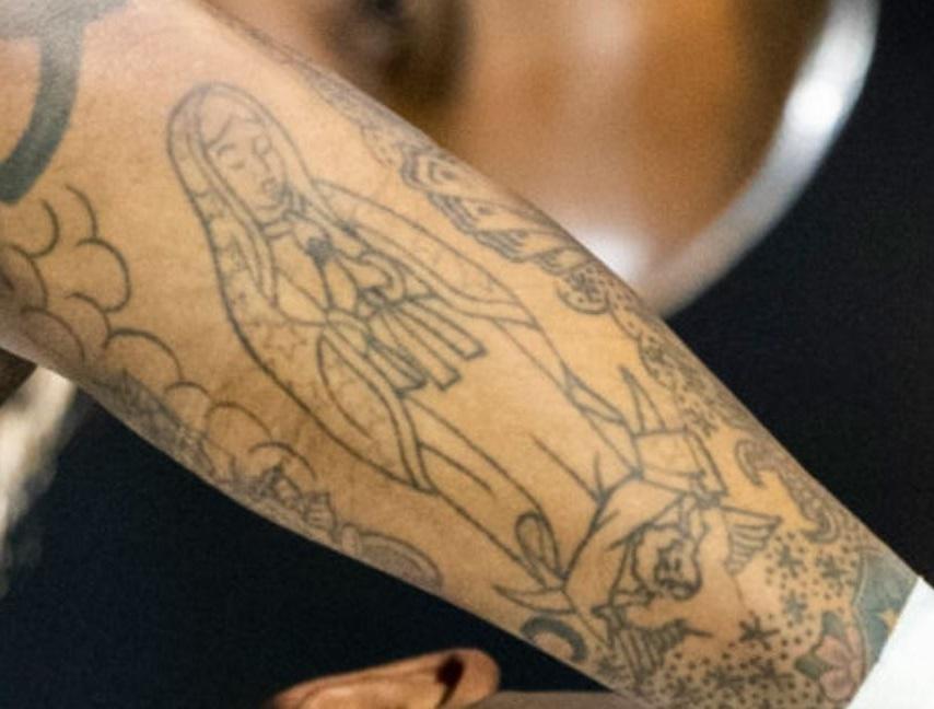 Tim female figure tattoo