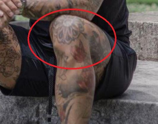 Tim flower on knee tattoo