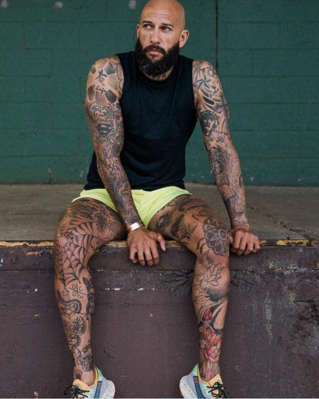Tim heavily tattooed body