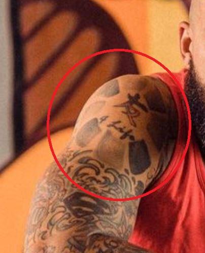 Tim shoulder tattoo