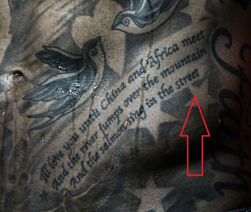 Tim stomach writing tattoo