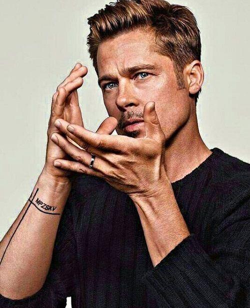 Brad Pitt Tattoo - Family Member Initials on Forearm