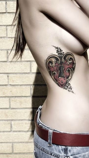 25 amazing love tattoos with meanings body art guru for Heart of gold tattoo