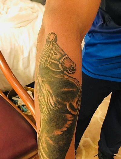 Horse tattoo on Jadeja's forearm