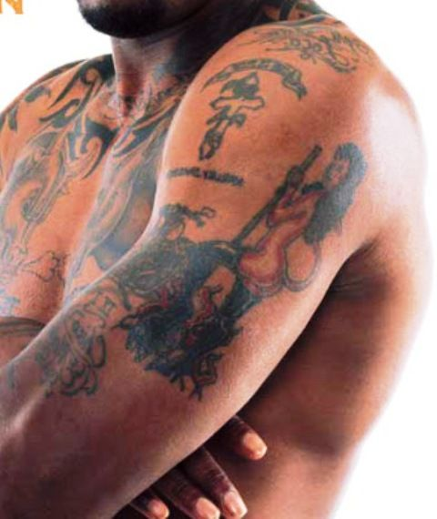 Dennis Rodman Left Arm Tattoos
