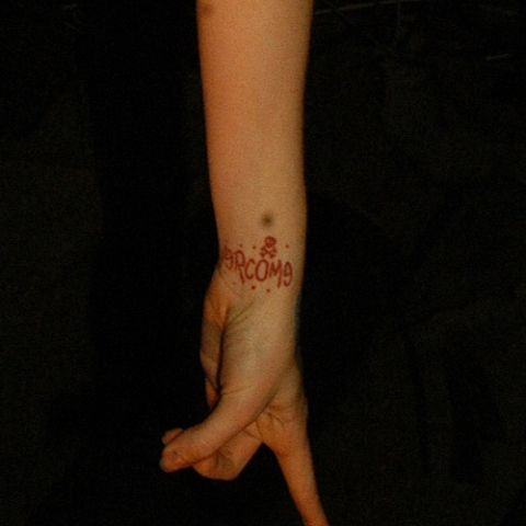 Maria Brink Overcome Wrist Tattoo