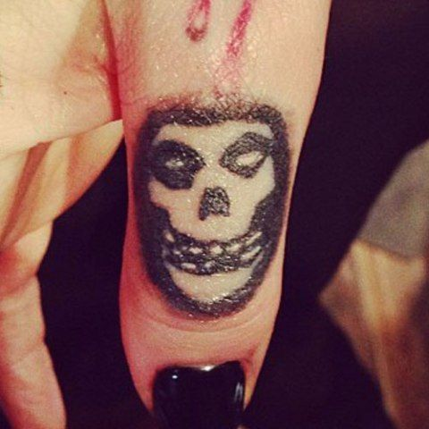 Ash Costello Skull On Thumb Tattoo