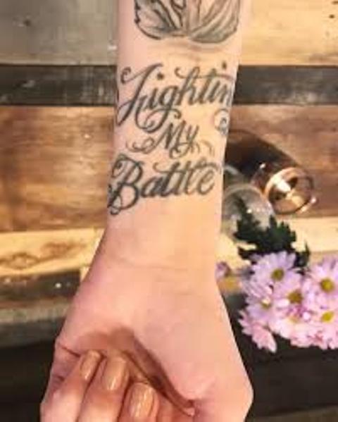 Carah Faye Writing On Wrist Tattoo