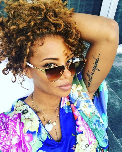 Eva Marcille Left Bicep Tattoo
