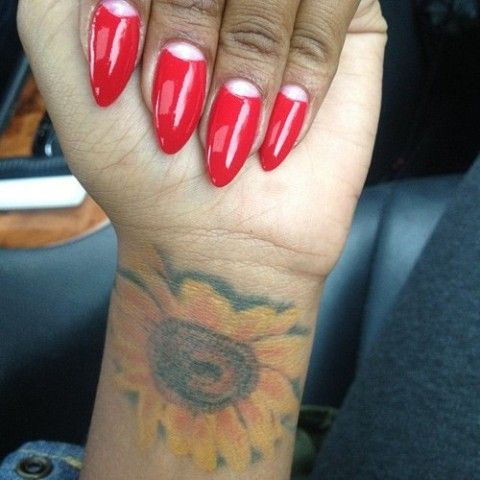 Eva Marcille Sunflower On Wrist Tattoo