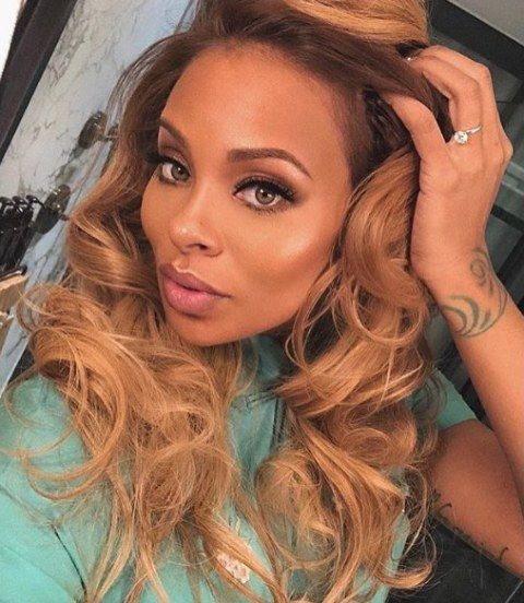 Eva Marcille Swirls Tattoo