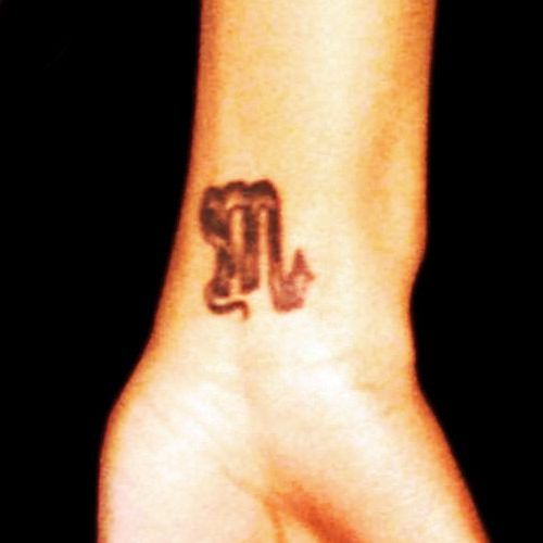 Monica Brown Scorpio Sign Tattoo