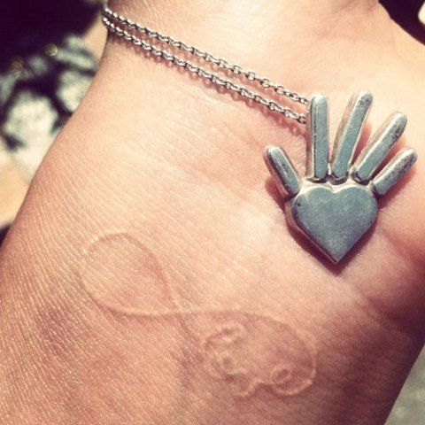Shay Mitchell Infinity Love Wrist Tattoo