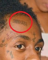Lil Wayne BAKED tattoo