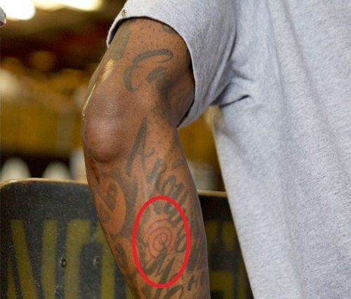 Lil Wayne red swirl tattoo