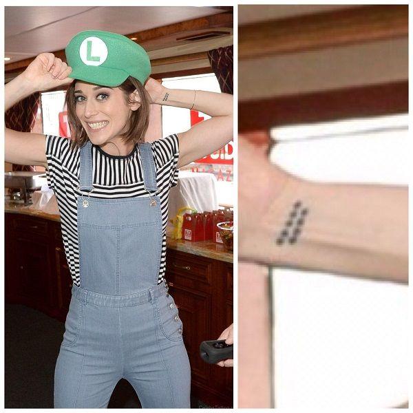 Lizzy Caplan Wrist Tattoo