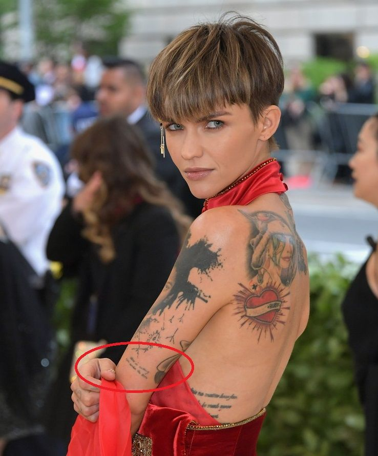 6f6bf0a5206aa Tattoo: A text saying 'There is nothing new under the sun' on her upper  left arm.