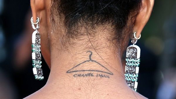 Chanel Iman Cloth hanger tattoo