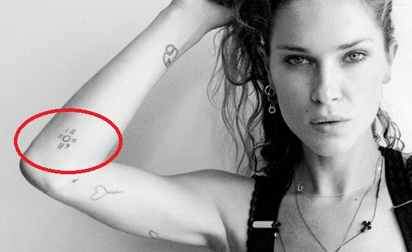 Erin Wasson Circle with lines tattoo