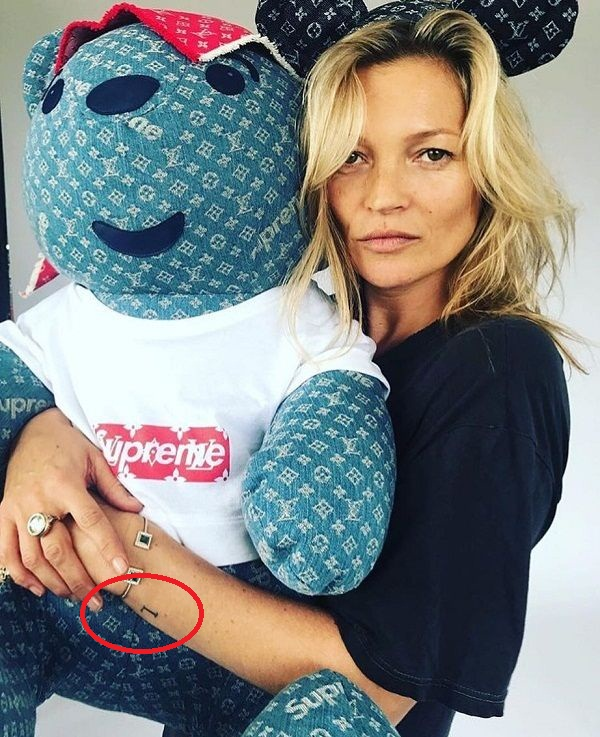 Kate Moss L tattoo