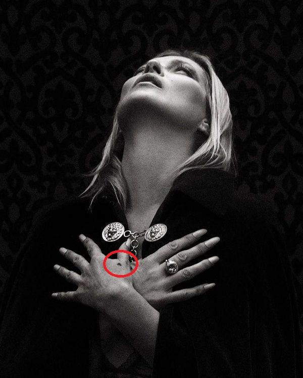 Kate Moss heart tattoo on hand