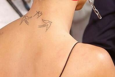 Zoe Kravitz Yes with two swallows tattoo