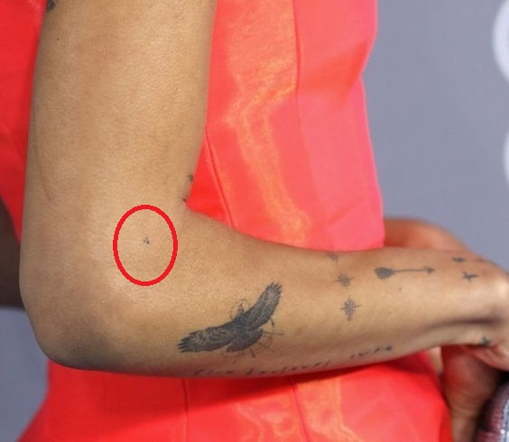 Zoe Kravitz tiny dots on elbow tattoo