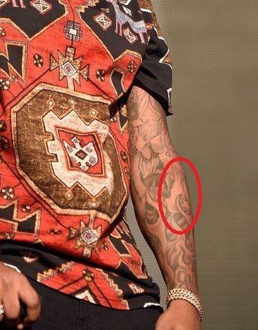 Flying Bird on his left fprearm-Future tattoos